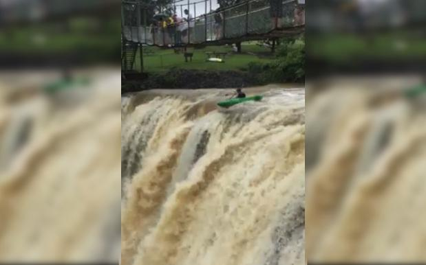 WATCH: Nutcase Kayaks Over Flood-Swollen QLD Waterfall & Survives Like NBD