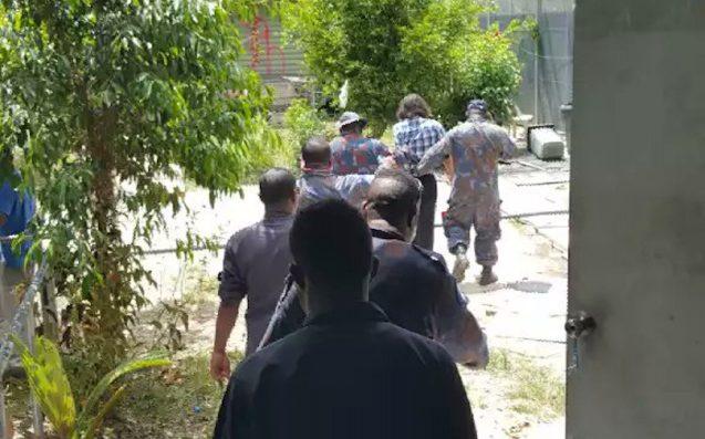 Papua New Guinea police flood closed Australia refugee camp on Manus Island