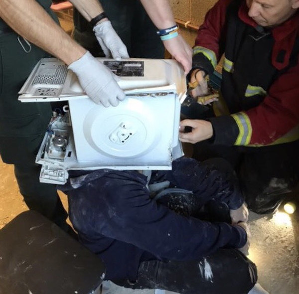 Prankster cements his head into a microwave, emergency services save him