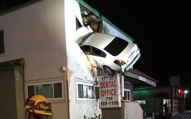 Vehicle goes airborne, slams into 2nd floor of California office
