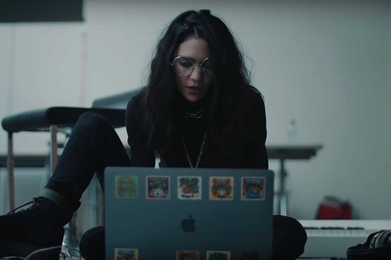 Grimes Is Channelling Some Srs '90s Goth Vibes In The New Apple Ad Campaign